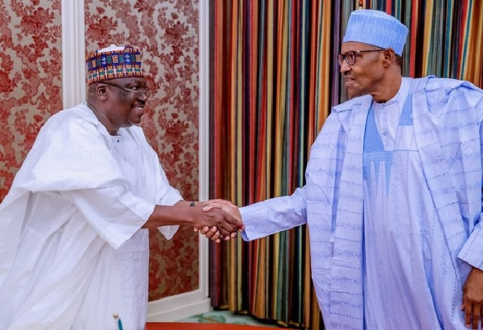 President Muhammadu Buhari in Handshake with the Senate President, Ahmad Lawan